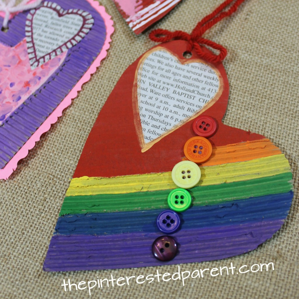 Mixed media corrugated cardboard hearts. Valentine's arts and crafts for kids.