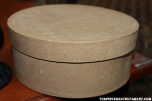 Start with a medium sized plain hat box. You can purchase on of these at a craft store for only a couple of dollars.