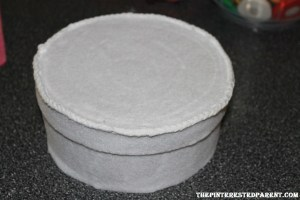 Cut and glue felt to cover the bottom half of the hat box as well. Allow to dry before proceeding.