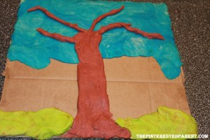 Add your tree trunk & grass using your dough.