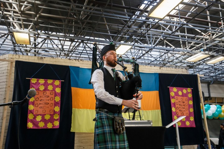 The Essex bagpiper on stage at the Green Street Festival in Newham London