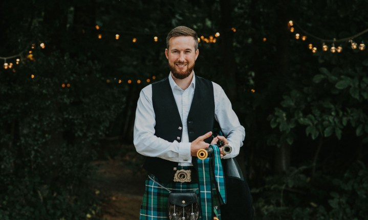 The Cambridge bagpiper pictured at Jason and Dani's wedding day