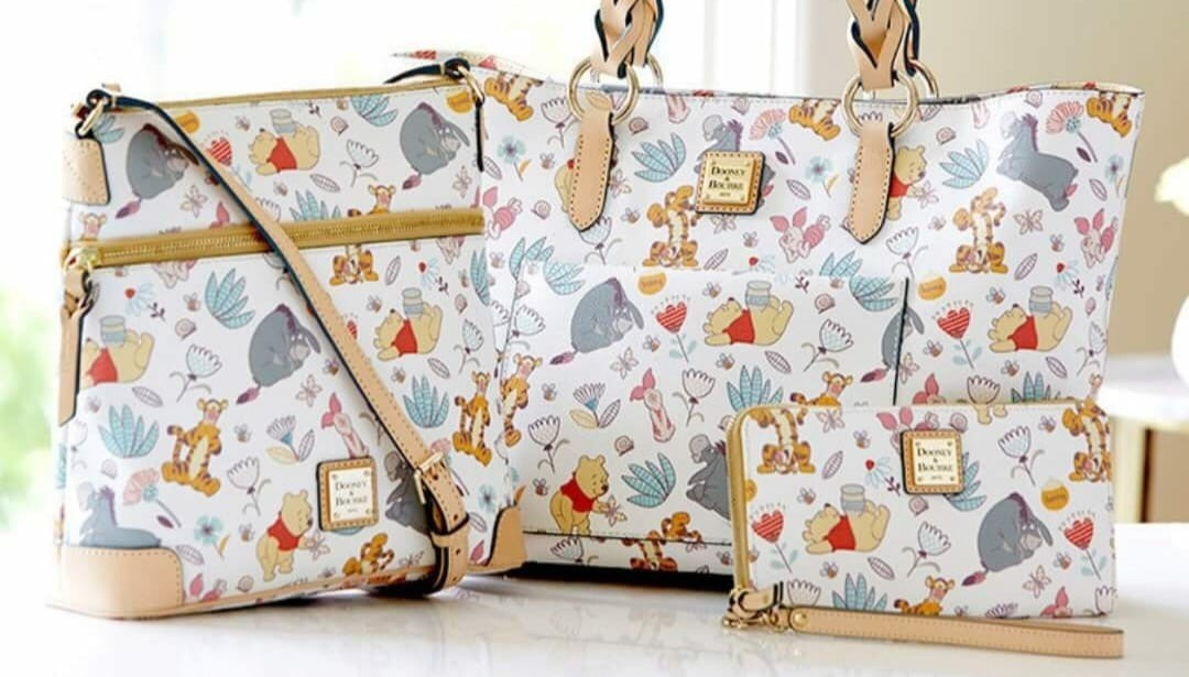 2580227a976 UPDATED RELEASE INFO  Winnie the Pooh Dooney and Bourke Coming Soon. Disney  Fashion onJuly ...