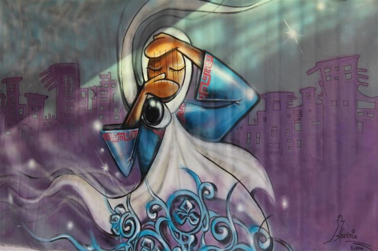 Afghanistans first female street artist risks her life to
