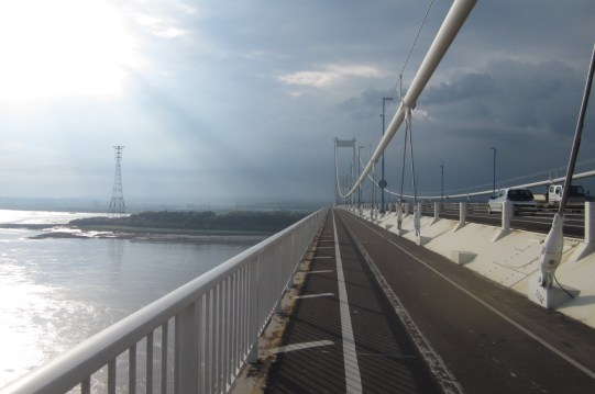 I had been anticipating this bridge as it marked my leaving southern England and it's horrible traffic. Here halfway across the Severn River, the bridge spanning 2 miles, looking into Wales and the heavy clouds looming.