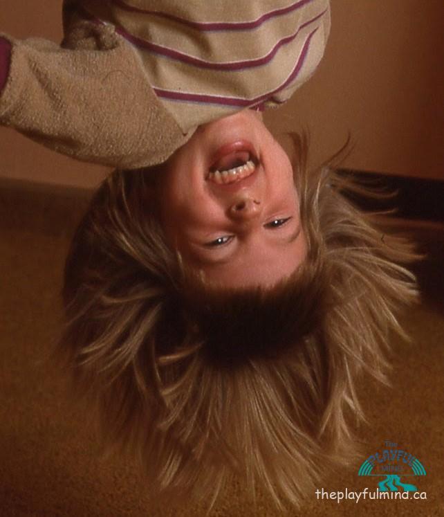 big sis hanging upside down