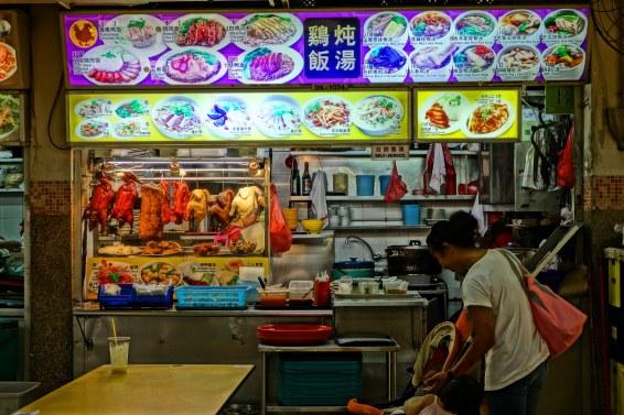 A food vendor with delicious duck.