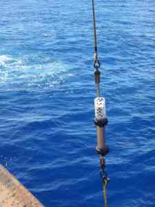 Hydrophone being lowered into the Challenger Deep trough in the Mariana Trench in 2015. (Photo credit: NOAA)