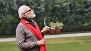 Prime Minister Narendra Modi on Thursday morning left netizens amused after he responded to a Twitterati who had tagged a picture of him trying to catch a glimpse of the last solar eclipse of the decade.