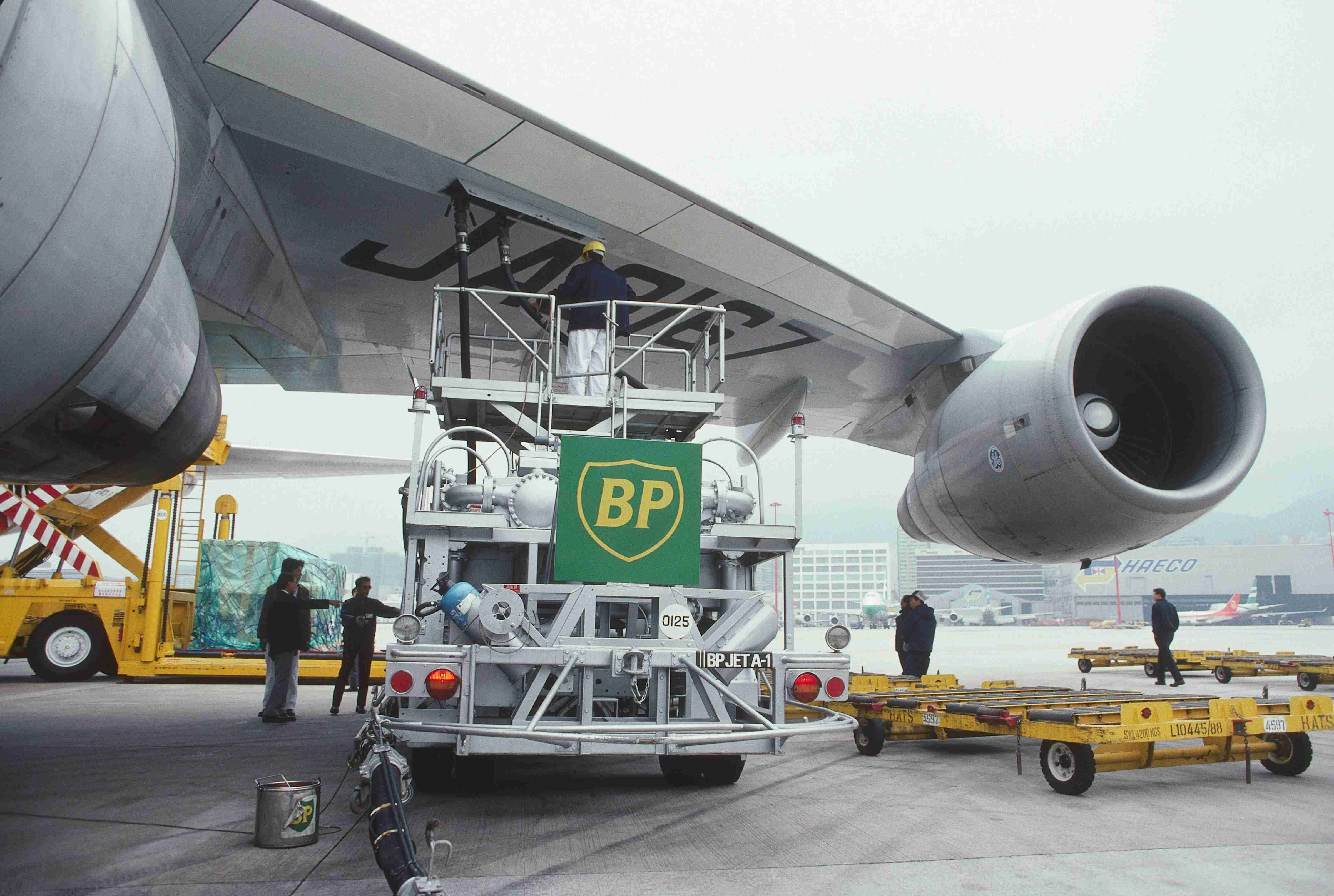 BP refuelling bowser under wing and a GE CF-6-50E2 engine intake of a Nippon Cargo Airlines Boeing 747-200F with cargo being loaded behind. (Photo by: aviation-images.com/Universal Images Group via Getty Images)