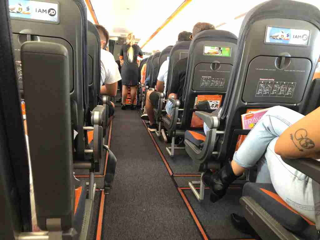 Passengers on an easyJet aircraft bound for Naples, Italy. Photo by Lori Zaino for The Points Guy UK.