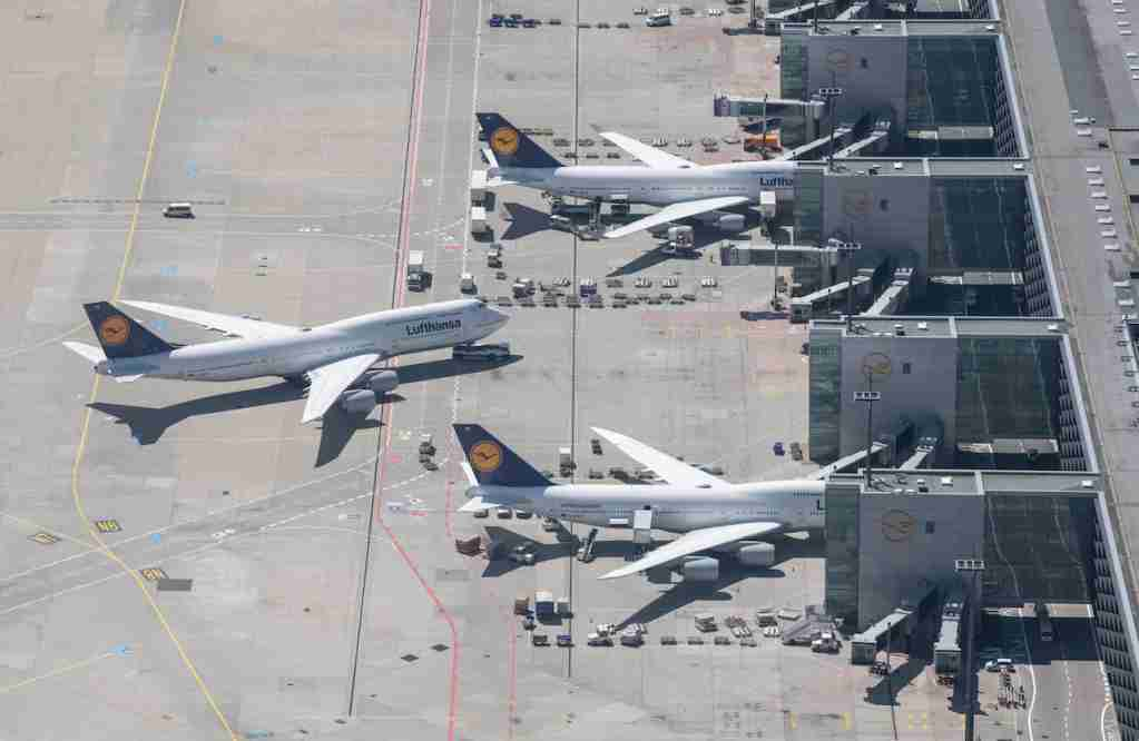 15 May 2019, Hessen, Frankfurt/Main: Lufthansa passenger aircraft are parked at their gates at Terminal 1 of the airport (pick-up from a helicopter). With the use of new technologies, the Federal Police wants to arm itself against illegal threats that were last seen last week at the airport. Photo: Boris Roessler/dpa (Photo by Boris Roessler/picture alliance via Getty Images)