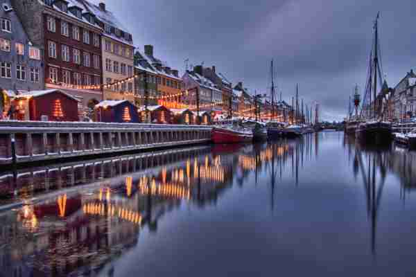 Reflection of houses at winter, Nyhavn, Copenhagen. (Photo by Kevin Grace / Getty Images)