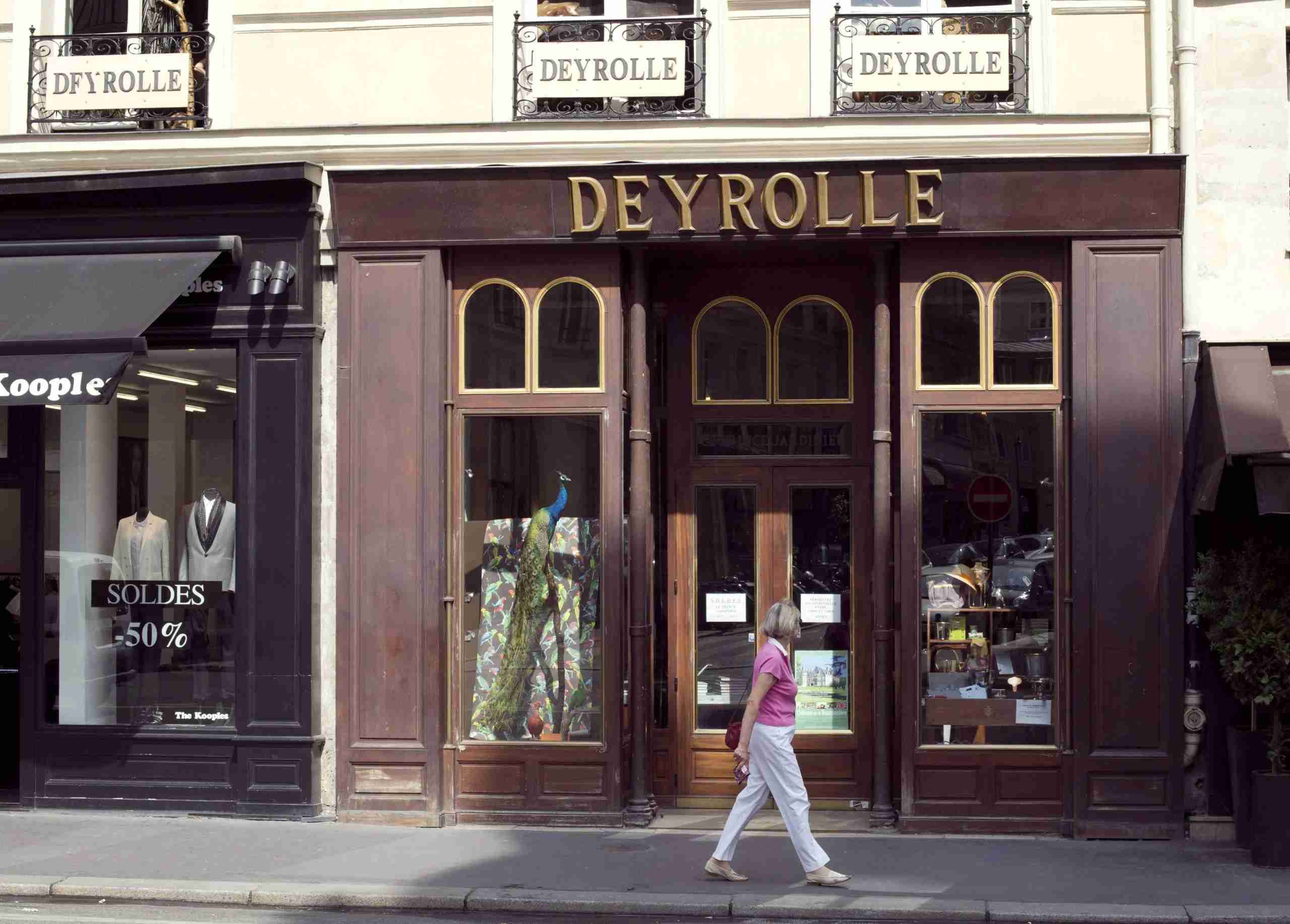A person walks in front of the Deyrolle shop in Paris on July 16, 2013, after repair work following a fire. Located rue du Bac since 1888, the shop attracts amateurs and collectioneurs, who come to discover naturalised animals, collections of insects, butterflies, entomological material, minerals and fossils, a well as the famous old and republished plates. Founded in 1831 by Jean-Baptiste Deyrolle, fond of natural history, the house rapidly has taken a pedagogical vocation. . AFP PHOTO / PATRICK KOVARIK (Photo credit should read PATRICK KOVARIK/AFP via Getty Images)
