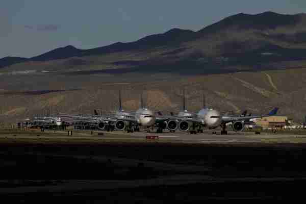 Delta Air Lines Inc. aircraft sit parked at a field in Victorville, California, U.S., on Monday, March 23, 2020. Delta Air Lines will park more than 600 planes, or about half its fleet, as it cuts flying capacity 70% amid collapsing travel demand from the coronavirus pandemic. Photographer: Patrick T. Fallon/Bloomberg via Getty Images