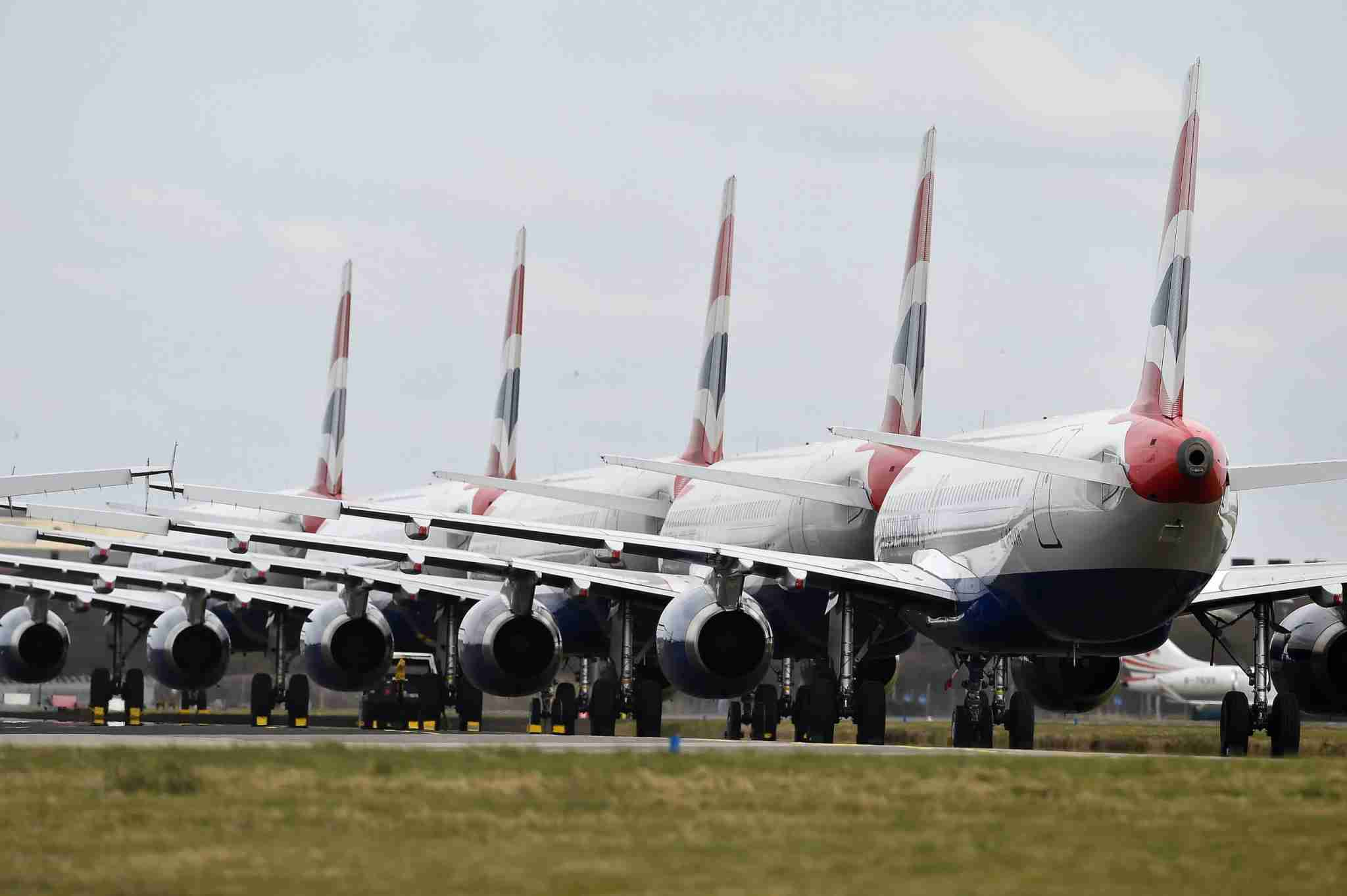 GLASGOW, SCOTLAND - MARCH 21: A grounded fleet of British Airway planes sit on the runway at Glasgow Airport on March 21, 2020 in Glasgow, Scotland. Coronavirus (COVID-19) has spread to at least 186 countries, claiming nearly 12,000 lives and infecting more than 286,000 people. There have now been 3,983 diagnosed cases in the UK and 177 deaths. (Photo by Jeff J Mitchell/Getty Images)