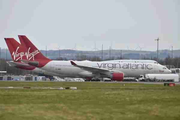 GLASGOW, SCOTLAND - MARCH 21: Virgin Atlantic planes sit on the runway at Glasgow Airport on March 21, 2020 in Glasgow, Scotland. Coronavirus (COVID-19) has spread to at least 186 countries, claiming nearly 12,000 lives and infecting more than 286,000 people. There have now been 3,983 diagnosed cases in the UK and 177 deaths. (Photo by Jeff J Mitchell/Getty Images)
