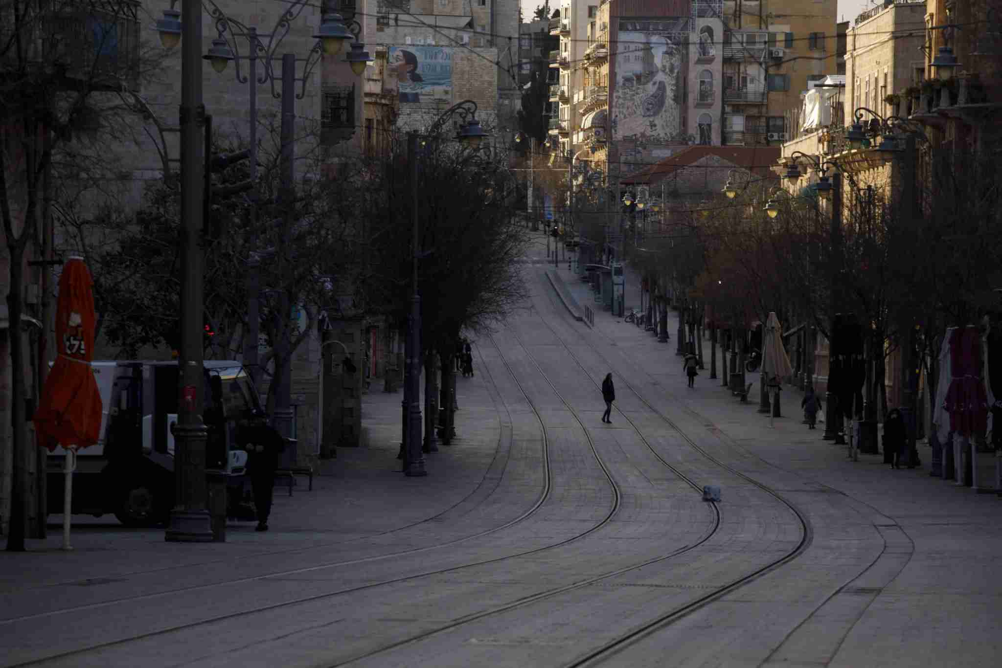 Pedestrians walk along a deserted street during lockdown in Jerusalem, Israel, on Sunday, March 29, 2020. The central bank said Sunday that both moves by its banking supervision department are aimed at boosting lenders ability to provide credit as the coronavirus outbreak hammers the local economy and markets. Photographer: Kobi Wolf/Bloomberg via Getty Images