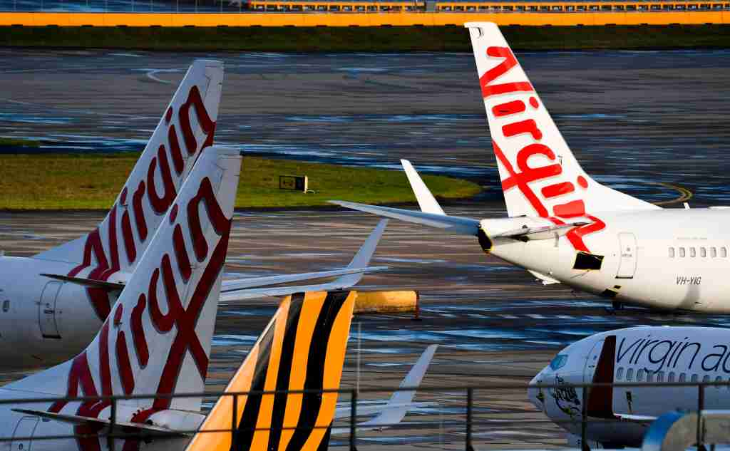 Planes from Australian airlines Tiger Air and Virgin sit idle on the tarmac at Melbourne