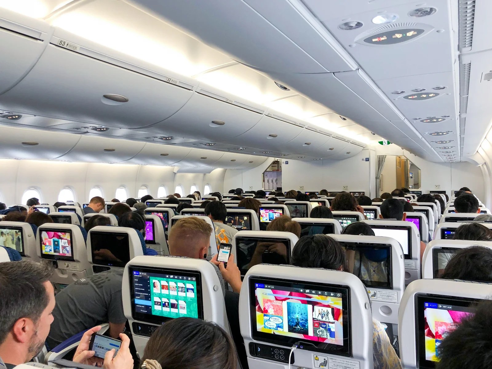 How far can airborne covid germs really spread on a plane?