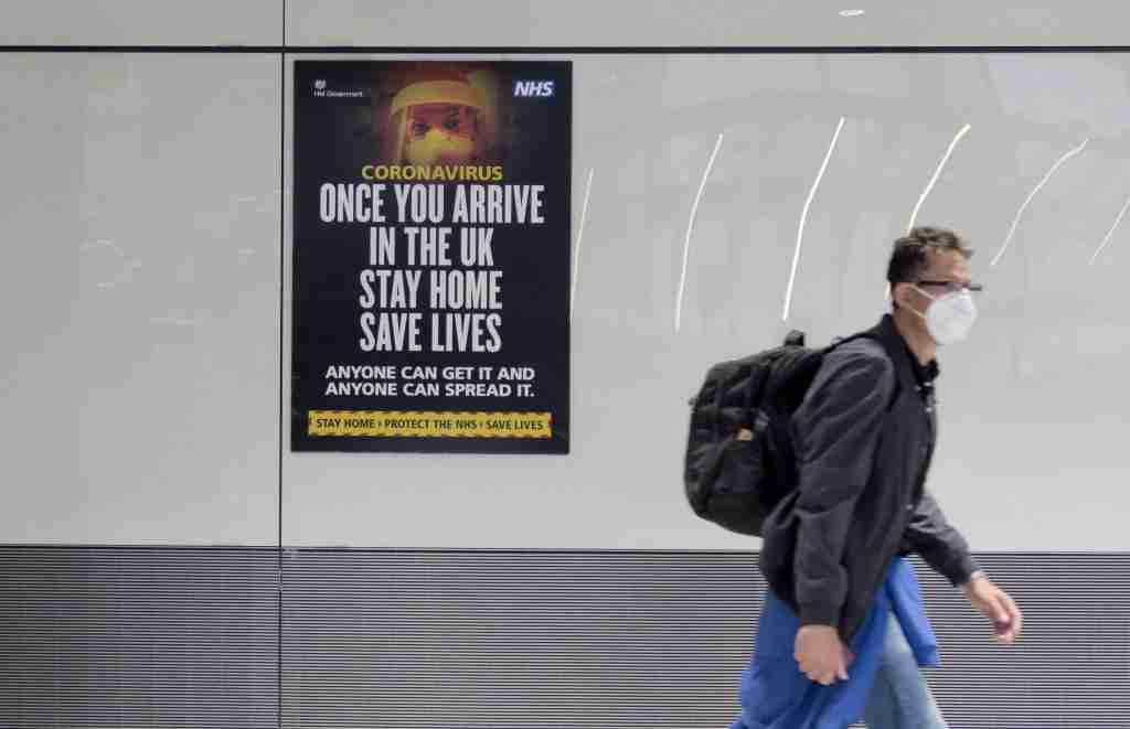 LONDON, May 1, 2020 .A passenger wearing a face mask arrives at Heathrow Airport in London, Britain, on May 1, 2020. British Health Secretary Matt Hancock said Friday that the country has met the goal of 100,000 tests per day as another 739 people with COVID-19 have died, bringing the total coronavirus-related death toll to 27,510 in Britain. As of Friday morning, 177,454 people have tested positive for the disease, said Hancock. (Photo by Tim Ireland/Xinhua via Getty) (Xinhua/ via Getty Images)
