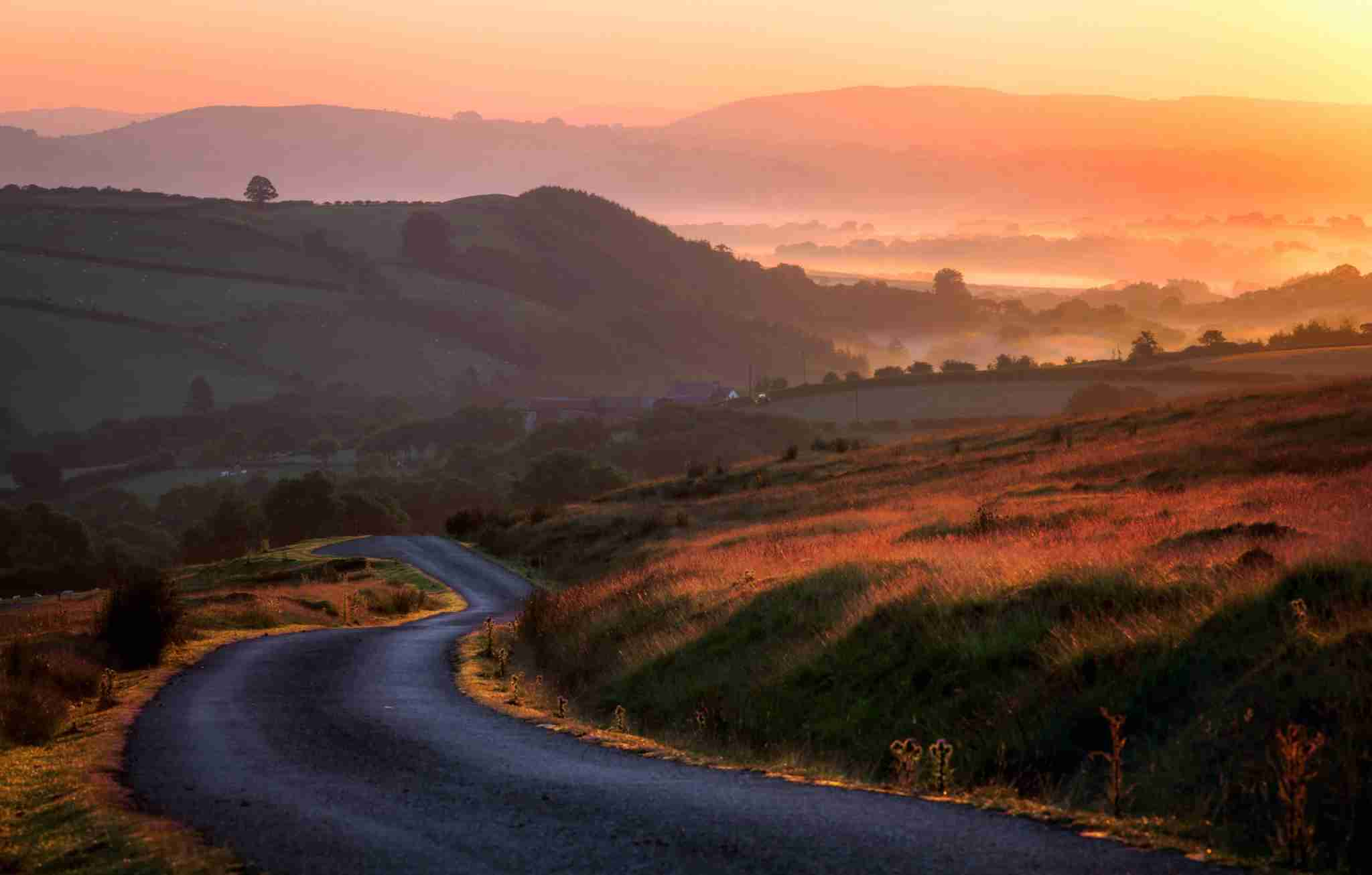 Mist over the valleys in the Brecon Beacons. (Photo by joe daniel price/Getty Images)