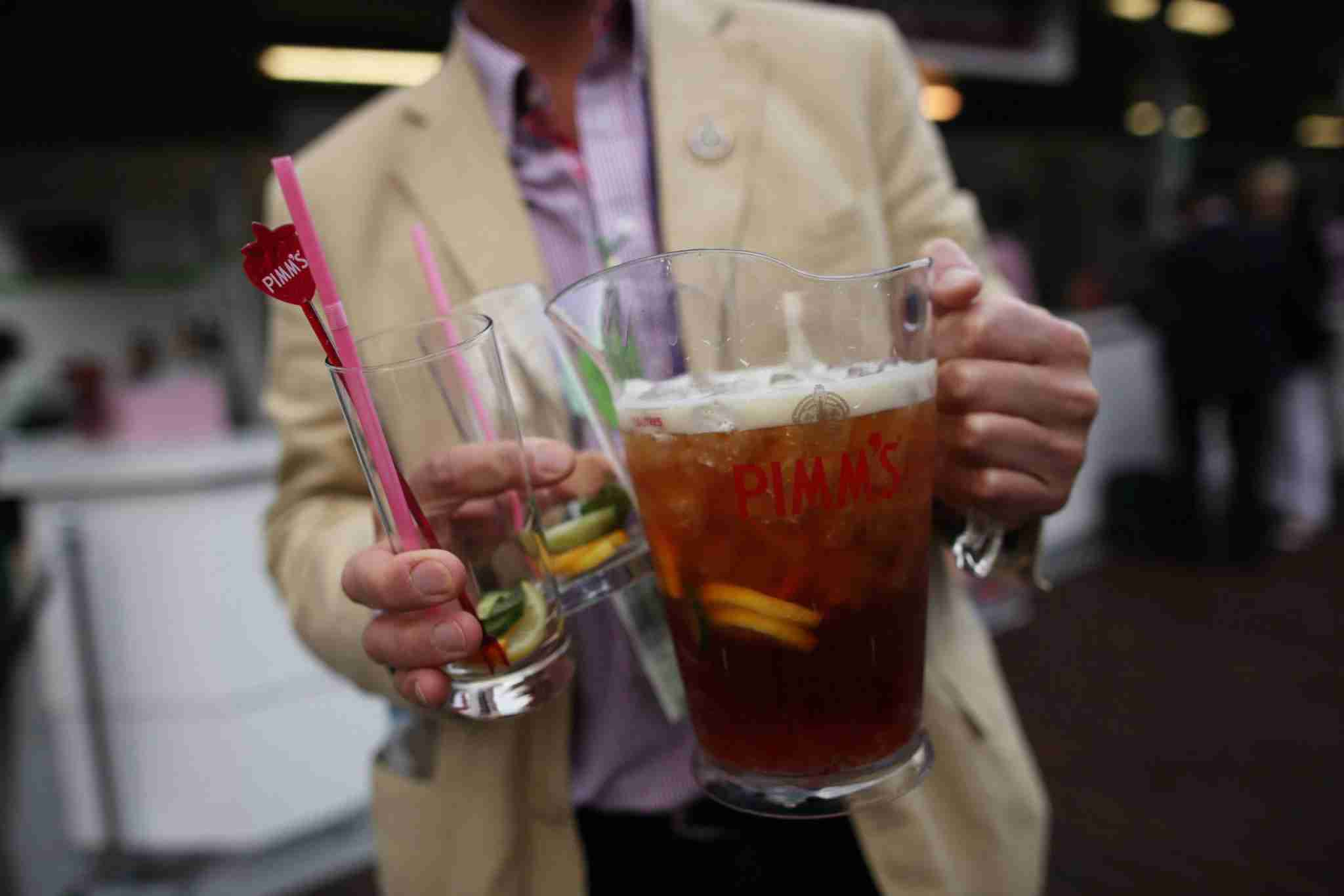 LONDON, ENGLAND - JUNE 25: A tournament goer carries a jug of pimms on day one of the Wimbledon Lawn Tennis Championships at the All England Lawn Tennis and Croquet Club on June 25, 2012 in London, England. (Photo by Dan Kitwood/Getty Images)