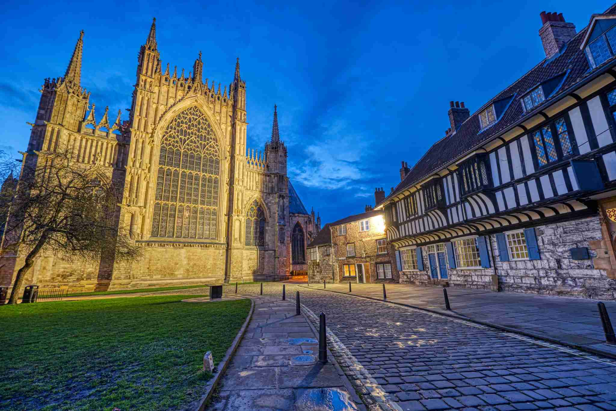 The backside of the York Minster and some half-timbered houses at dusk