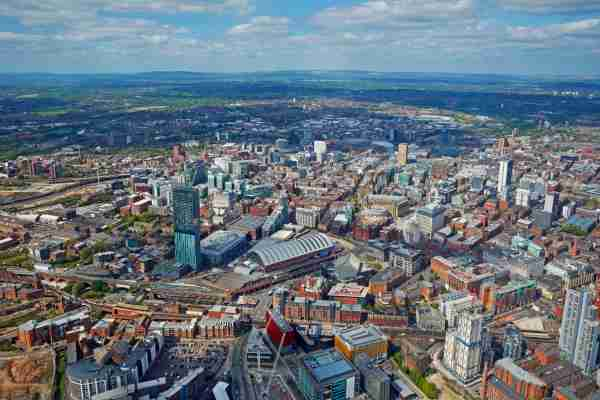 Aerial view of the city centre of Manchester with the Beetham Tower and Manchester Central Convention Complex (Photo by Allan Baxter/Getty)