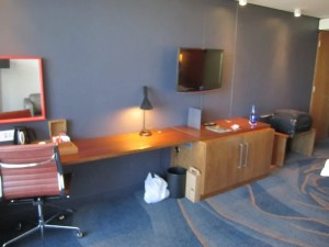 The small desk and minibar area - nothing stocked in the fridge unless you ask.