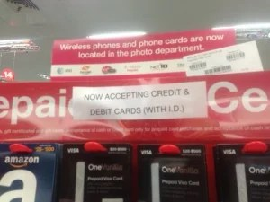Some CVS stores are displaying the new policy that you may buy these cards with debit or credit cards.