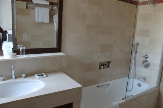 Simple, well-lit bathroom at Hôtel du Louvre