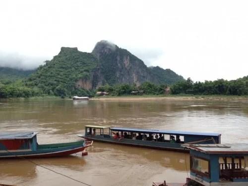 Riverboats mooring at the Pak Ou Caves.