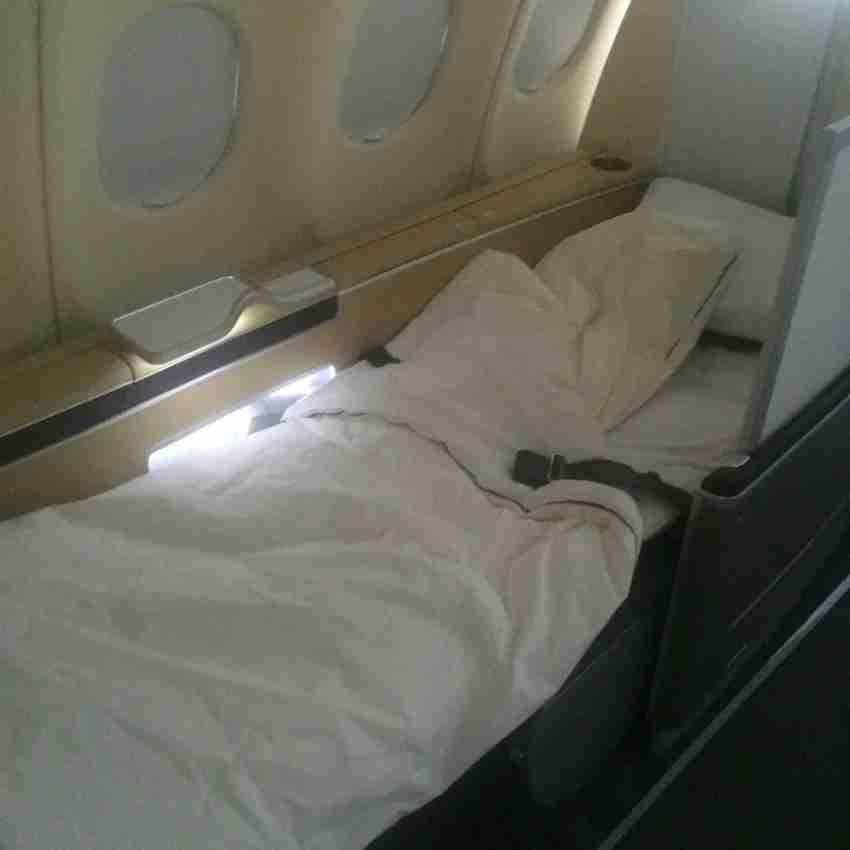 My first class seat in full lie-flat position on Lufthansa