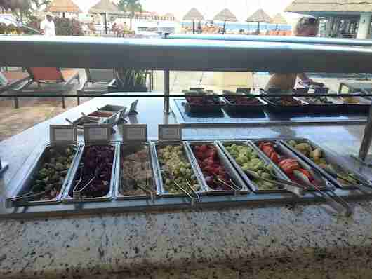 The poolside buffet of salads and fruit