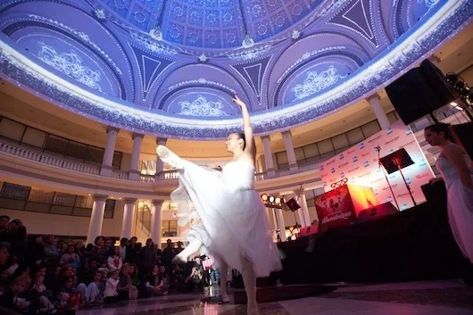 A ballerina performs under the Westfield San Francisco Centre's beautifully lit Dome.