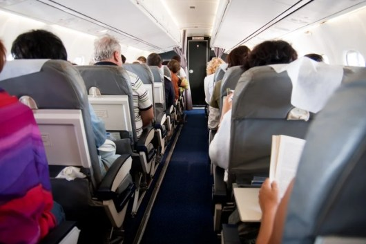 Getting stuck in a middle seat on a long flight is not fun. Photo courtesy of Shutterstock.