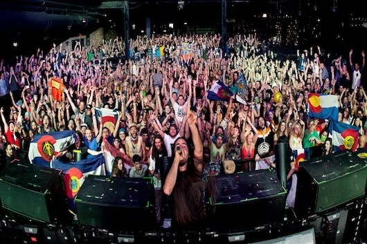 Bassnectar takes a picture with his fans.