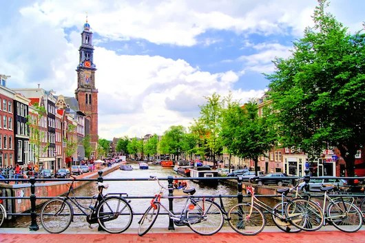 Canals and bicycles in Amsterdam. Photo courtesy Shutterstock.