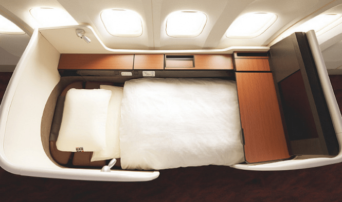 JAL's suite seats recline to a bed that's almost 80 inches long.