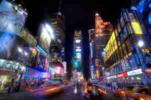 Times Square in New York City is already lights up like fireworks - add in New Year