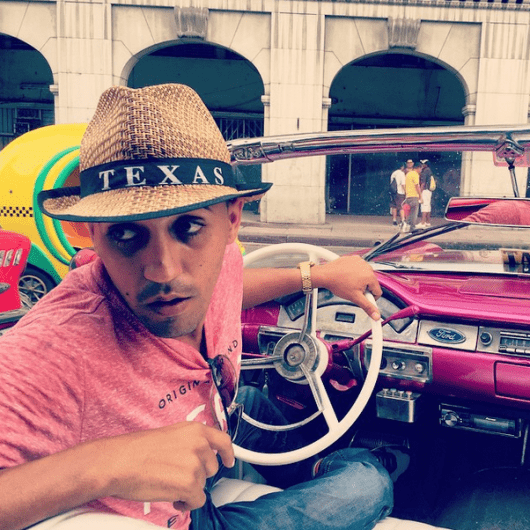 Texas by way of Cuba, at the wheel of a pink 1957 Thunderbird