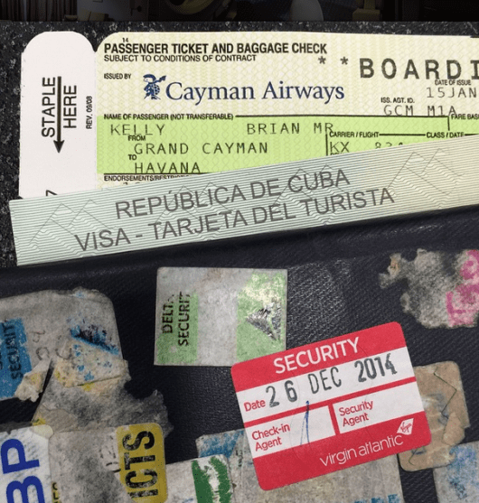 As you can see, there is a small piece of paper between my boarding pass and passport: my Cuban temporary $20 Visa slip