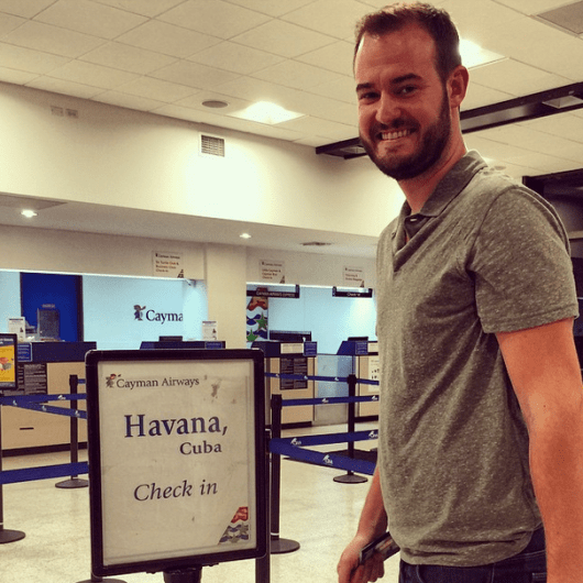 Yours truly checking in at Grand Cayman for my connecting flight—to Cuba!