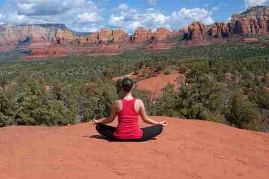 Doing yoga outdoors in the Arizona sunshine is a marvelous idea. Photo courtesy of Shutterstock.