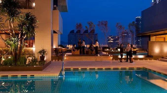 The outdoor pool at the DoubleTree Kuala Lumpur is also where you'll find Tosca, a casual Italian dining spot