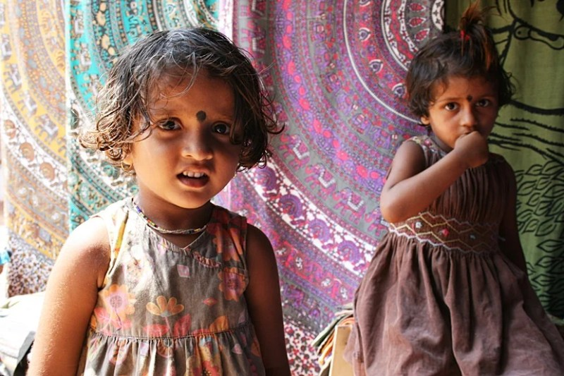Shopping in India is fun, and these two little girls helped me choose some great gifts at a street market. Photo by Lori Zaino.