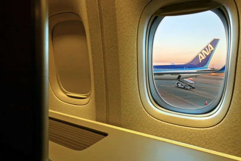 ANA's 777-300ER first class is arranged in a 1-2-1 configuration, so each of the window seats also has aisle access.