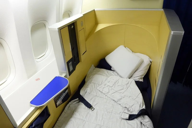 The flight attendant converted the empty seat next to mine into a bed.