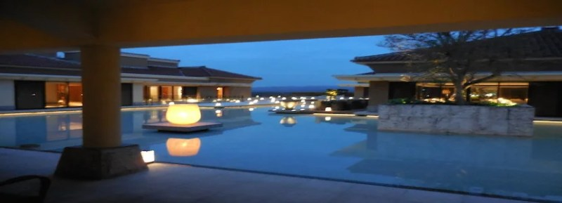 The public spaces on the main floor encircle a shallow pool that looks incredible at night.